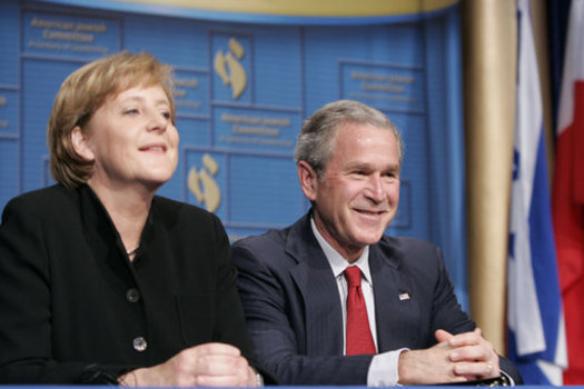 Bush grins that inscrutable grin